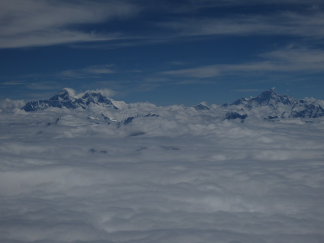 Flying over the Himalayas on the way to Nepal, that's Mount Everest on the left!