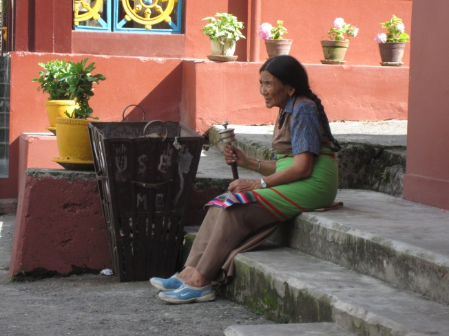 A Nepali woman sits outside the Jangchub Choeling Monastery in Pokhara.